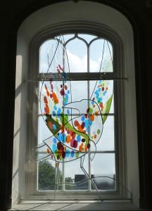 Raaf Vincentius Reduzum  kerkraam glaskunst Moglas